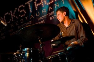 Zach Forsyth on the drums at the Backstage Restaurant.