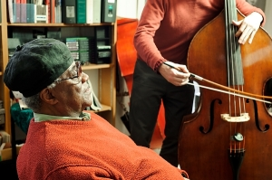 Richard Davis, professor of music at the University of Wisconsin-Madison, works with First Last during a one-on-one learning session in his office in the Mosse Humanities Building on April 21, 2011. (Photo by Bryce Richter / UW-Madison)