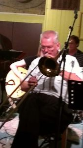 Mr. Joe (Pinson) playing trombone during First Tuesday at Banter Bistro.