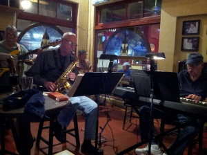 Sweetwater Jazz Quartet - Jim Riggs, sax; Neil Slater, keyboard; Lou Carfa, bass; Ron Fink, drums - play the last performance at the Meredith Sweetwater Grill & Tavern. Photo by Lance Hoffmeyer, March 11, 2014.