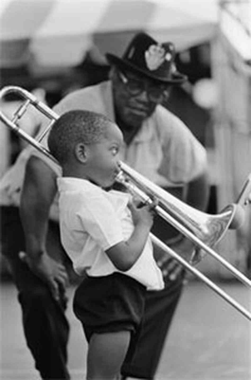 A very young Trombone Shorty plays while Bo Diddly looks on.